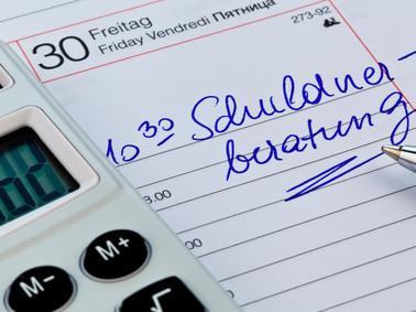 Terminkalender mit Eintrag für Schuldnerberatung